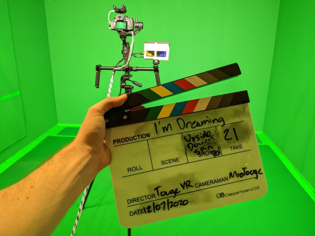 Clapboard showing 21 takes against a green screen background